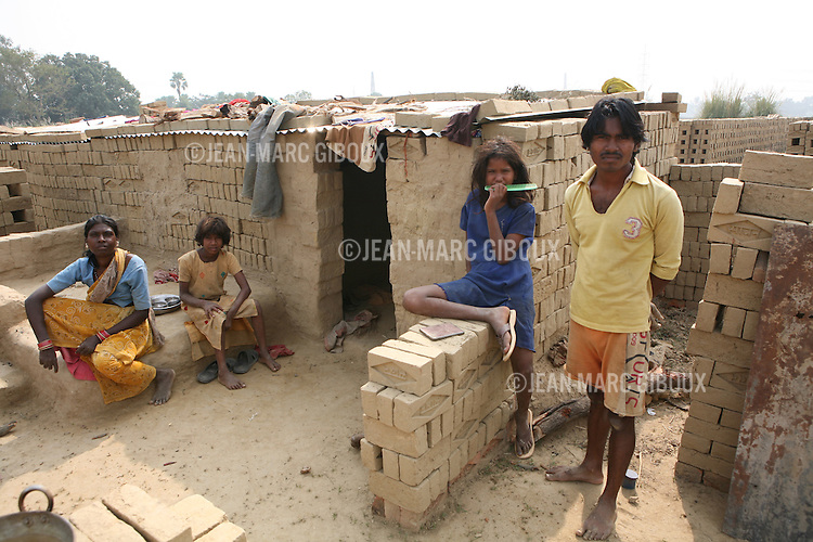 The brick kilns - brick factories , that surround the city of Lucknow are high risk areas for polio transmition. The migrant workers who labor here have many young children and are targeted by mobile polio vaccination teams..Takurkila area near Lucknow..India has been engaged in a campaign to eradicate polio in India which target the high-risk area of Uttar Pradesh and Bihar with polio immunization drives every 2 months.  (photo Jean-Marc Giboux)