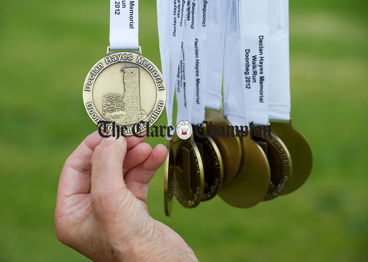 Medals await their takers during the Declan Hayes Memorial Doonbeg Half Marathon/10K Fun Run and Walk. Photograph by John Kelly.