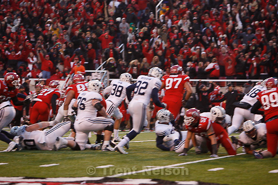 Trent Nelson  |  The Salt Lake Tribune..Brandon Burton blocks a field goal attempt by BYU kicker Mitch Payne (38) to win. Utah beats BYU on a blocked field goal attempt at Rice-Eccles Stadium Saturday, November 27, 2010. The final score was Utah 17-BYU 16.