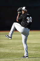 Birmingham Barons pitcher Nestor Molina (30) throws in the outfield during practice before a game against the Chattanooga Lookouts on April 24, 2014 at AT&T Field in Chattanooga, Tennessee.  Chattanooga defeated Birmingham 5-4.  (Mike Janes/Four Seam Images)