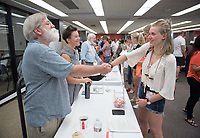 Natasha Carpenter-Frank '21 talks with associate professor of writing & rhetoric Thomas Burkdall, Academic Department Information Fair in the Academic Commons.  Incoming first-years and their families are welcomed by O-Team members and the community at the start of Occidental College's Fall Orientation for the class of 2021, Aug. 24, 2017.<br /> (Photo by Marc Campos, Occidental College Photographer)