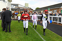 Jockeys enter the Parade Ring during Afternoon Racing at Salisbury Racecourse on 16th May 2019