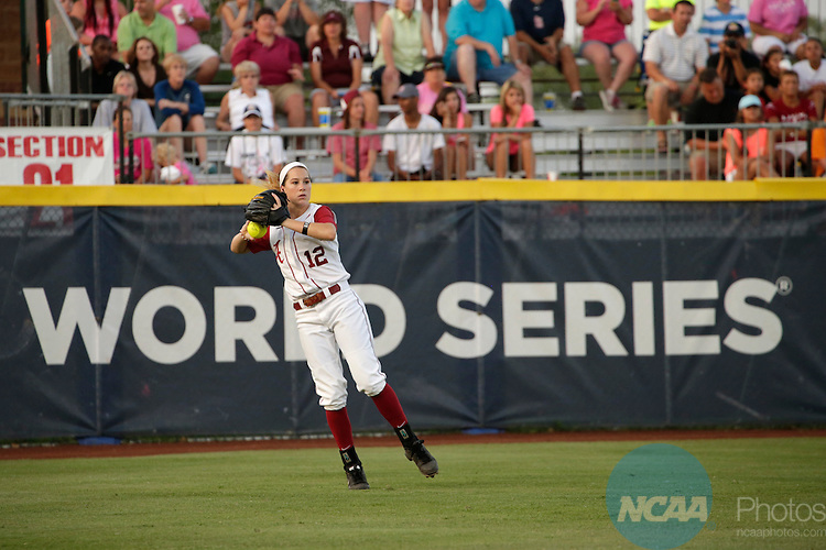 02 JUNE 2014:   Kallie Case (12) of the University of Alabama fields a hit against the University of Florida during the Division I Women's Softball Championship held at ASA Hall of Fame Stadium in Oklahoma City, OK.  Florida defeated Alabama 5-0 in Game One.  Shane Bevel/NCAA Photos