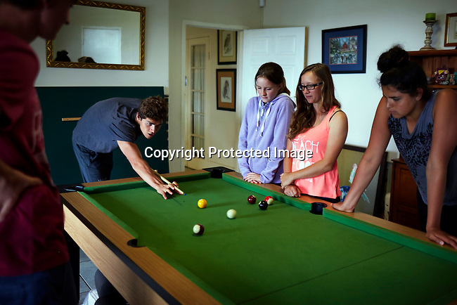 HOWICK, SOUTH AFRICA APRIL 5: Sixteen-year-old swimmer Michael Andrew plays pool with friends on April 5, 2015 in Howick, Natal, South Africa. Michael has broken many records already and he is seen as the new Michael Phelps. He turned pro at 14 after signing his first endorsement deal. Peter, his father trains Michael and he grew up in the US. His parents emigrated from South Africa and he spent some time in the country in April 2015 to visit his grandparents. (Photo by: Per-Anders Pettersson)