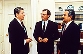 United States President Ronald Reagan meets in the Oval Office of the White House in Washington, DC with Thomas Loeffler, center, and Cres Arcos, right, Congressional and Public Diplomacy Coordinators, respectively, for the President's campaign to secure additional aid for the Nicaraguan Democratic Resistance on July 15, 1987.<br /> Mandatory Credit: Bill Fitz-Patrick / White House via CNP