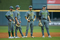 (L-R) Baylor Bears infielders Esteban Cardoza-Oquendo (52), Nick Loftin (2), Ricky Martinez (11), and Chase Wehsener (37) wait for the new pitcher to complete his warm-ups during the game against the Arkansas Razorbacks in game nine of the 2020 Shriners Hospitals for Children College Classic at Minute Maid Park on March 1, 2020 in Houston, Texas. The Bears defeated the Razorbacks 3-2. (Brian Westerholt/Four Seam Images)