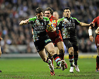 Tom Williams of Harlequins is tackled by Alex Goode of Saracens during the Aviva Premiership match between Harlequins and Saracens at Twickenham on Tuesday 27 December 2011 (Photo by Rob Munro)