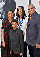 "LOS ANGELES, USA. June 04, 2019: Reginald Hudlin, Chrisette Suter & Children at the premiere for ""The Black Godfather"" at Paramount Theatre.<br /> Picture: Paul Smith/Featureflash"