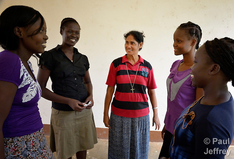Sister Sneha Joseph (center), a member of the Missionary Sisters Servants of the Holy Spirit, talks with students at the Catholic Health Training Institute in Wau, South Sudan, which trains nurses and midwives in the newly independent country. Sister Joseph, from India, is principal of the Institute, which is coordinated by Solidarity with South Sudan, an international consortium of more than 200 religious congregations that trains teachers, health workers and pastoral personnel in several locations throughout South Sudan.