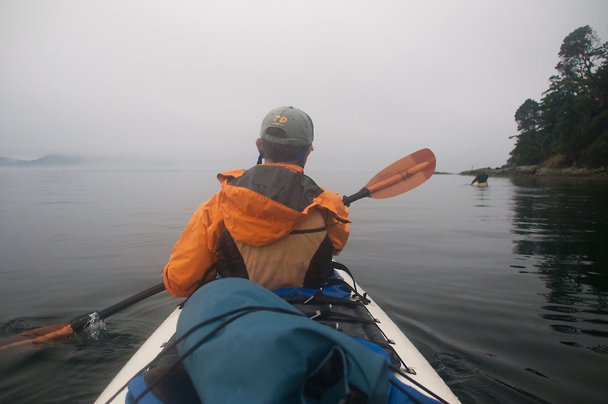 Taylor Paddles Oout of Reid Harbor in the Fog, Stuart Island, Washington, US