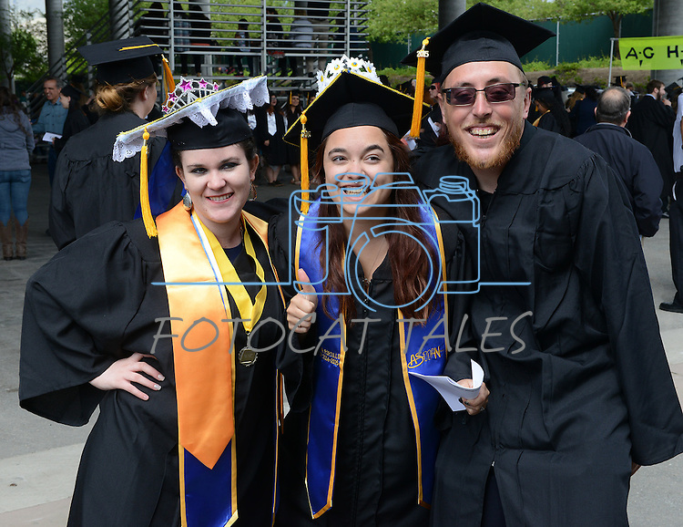 From left, Fallon graduates Donita Petean, Jessica Portillo and Matthew Tholl clown around for a photo prior to the 2015 Western Nevada College Commencement held at the Pony Express Pavilion in Carson City, Nev., on Monday, May 18, 2015.<br /> Photo by Tim Dunn