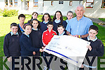 Eddie Sheehy, Kenya Education Project, pictured as he accepted a cheque for ?800 from the confirmation class of Coolick National School, Kilcummin, who donated their confirmation money to the charity on Tuesday. Pictured are Craig O'Riordan, Ruairi Counihan, Aaron Healy, Tomas O'Connor, Amy O'Sullivan, Laura Teahan, Zara Blackwell, Marie O'Shea, Aine O'Donoghue and Grace Foley with teacher Irene O'Keeffe. ...................................