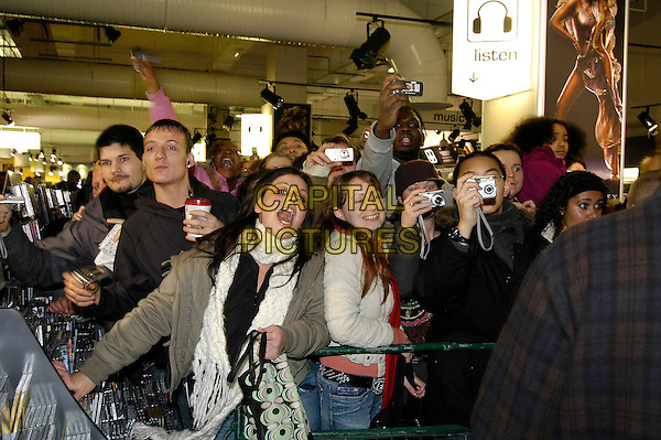 """CROWD.meets fans and signs copies of her award-winning album """"The Emancipation Of Mimi: Ultra Platinum Edition"""".at HMV Oxford Street .London England 4 December 2005.Ref:HT.fans crowd audience camera cameras screaming frantic excited.www.capitalpictures.com.sales@capitalpictures.com.©Capital Pictures"""
