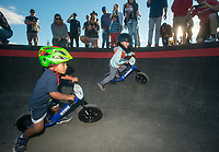 NWA Democrat-Gazette/BEN GOFF @NWABENGOFF<br /> Jesse McCourt (left), 3, of Springdale passes Beckett McGraw, 4, of Bentonville to win the final of the age 3-4 race Wednesday, Oct. 10, 2018, during the Strider Bikes pump track races at The Jones Center's Runway Bike Park in Springdale. Children ages 3-6, divided into two age groups, raced head-to-head to see who was the fastest on the balance bikes designed to help young children learn how to ride. It was the first competetive event to use the new pump track that was built to host the Red Bull Pump Track World Championship Final coming up Saturday.