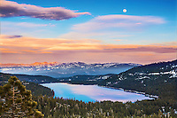 A photo of the full moon rising over Donner Lake in the Sierra mountains, Ca.