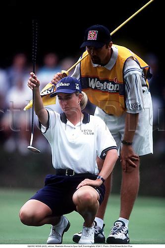 KARRIE WEBB (AUS) lines up a putt, winner, Weetabix Woman's Open Golf, Sunningdale, 970817. Photo: Chris Brown/Action Plus...1997.golfer golfers.woman