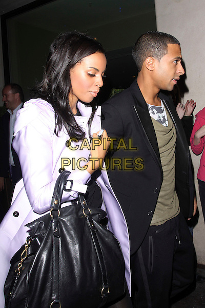 ROCHELLE WISEMAN OF THE SATURDAYS & MARVIN HUMES of JLS.At The May Fair Hotel, London, England, UK, October 7th 2010..Mayfair half length green khaki t-shirt black jacket couple purple lilac mac trench coat bag side profile .CAP/AH.©Adam Houghton/Capital Pictures.