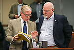 Nevada Sen. David Parks, D-Las Vegas, left, and Assemblyman Randy Kirner, R-Reno, talk on the Assembly floor at the Legislative Building in Carson City, Nev., on Sunday, May 31, 2015.  <br /> Photo by Cathleen Allison