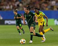 GRENOBLE, FRANCE - JUNE 18: Lisa De Vanna #11 of the Australian National Team dribbles as Sashana Campbell #12 of the Jamaican National Team defends during a game between Jamaica and Australia at Stade des Alpes on June 18, 2019 in Grenoble, France.