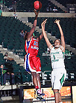 South Alabama Jaguars forward Christian Shelter (21) shoots over North Texas Mean Green forward Ash'Lynne Evans (1) during the NCAA Women's basketball game between the South Alabama Jaguars and the University of North Texas Mean Green at the North Texas Coliseum,the Super Pit, in Denton, Texas. South Alabama defeated UNT 79 to 61.