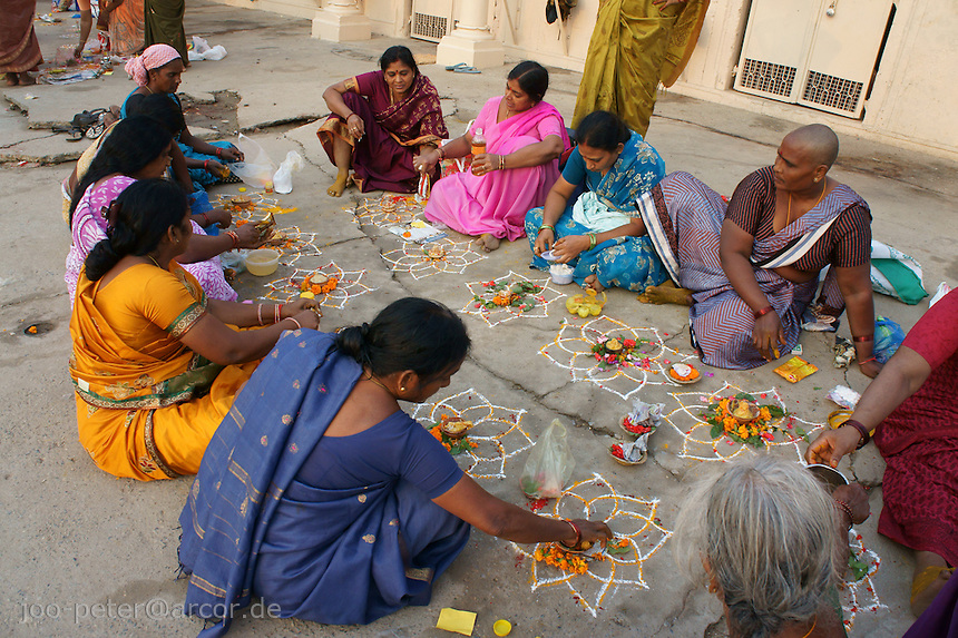 Women carry out  their prayer offerings on the plaza of the main Ghat of river Ganga in Varanasi (Dashaswamedh Ghat)
