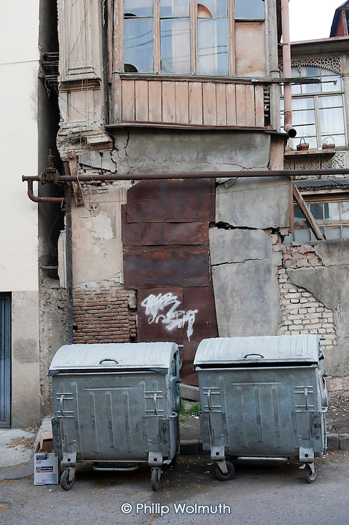 New municipal rubbish collection bins in Old Tbilisi, Georgia, part of an upgrade to the waste collection and disposal service introduced by the city council. Many buildings in the district are in serious disrepair.