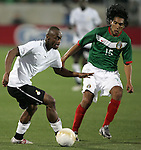 1 March 2006: Ghana's Elvis Hammond (l) and Mexico's Mario Perez (15). The National Team of Mexico defeated the National Team of Ghana 1-0 at Pizza Hut Park in Frisco, Texas in an International Friendly soccer match.