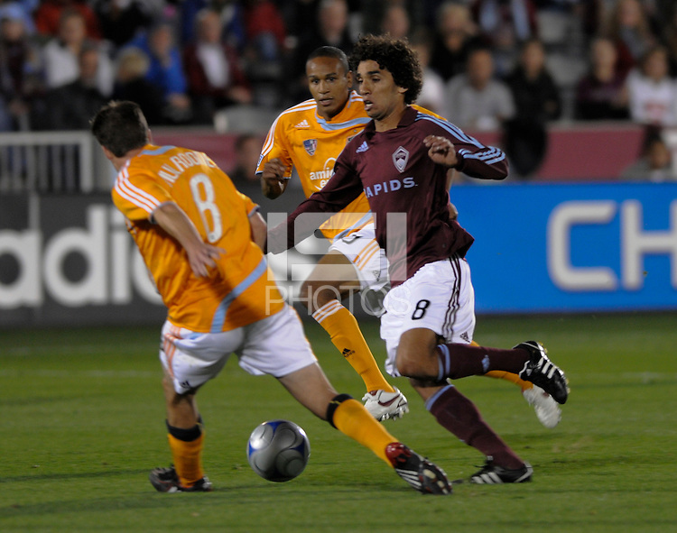 Colorado midfielder Mehdi Ballouchy (8, red) is surrounded by Houston's Richard Mulrooney and Ricardo Clark. The Houston Dynamo defeated the Colorado Rapids 3-1 at Dick's Sporting Goods Park, Denver, Colorado. Saturday, October 4, 2008. Photo by Trent Davol/isiphotos.com.