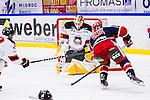 S&ouml;dert&auml;lje 2014-01-06 Ishockey Hockeyallsvenskan S&ouml;dert&auml;lje SK - Malm&ouml; Redhawks :  <br />  Malm&ouml; Redhawks m&aring;lvakt Robin Rahm r&auml;ddar ett skott p&aring; m&aring;l av S&ouml;dert&auml;ljes Jacob Jake Marto bara sekunder kvar av ordinarie matchtid<br /> (Foto: Kenta J&ouml;nsson) Nyckelord: