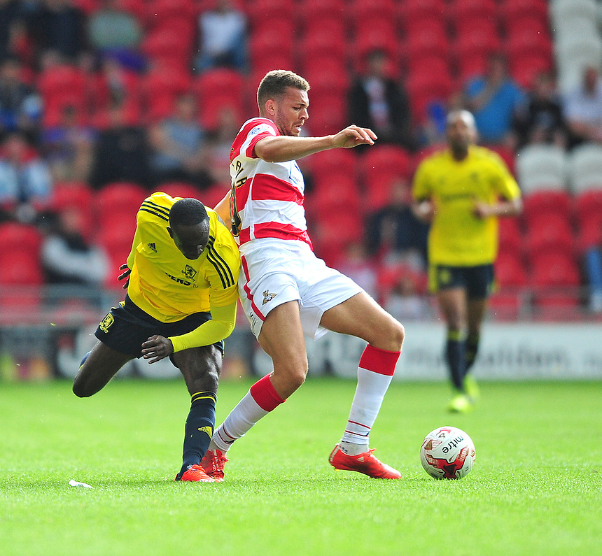 Middlesbrough's Albert Adomah vies for possession with Doncaster Rovers&rsquo; Aaron Taylor-Sinclair<br /> <br /> Photographer Chris Vaughan/CameraSport<br /> <br /> Football - Pre-Season Friendly - Doncaster Rovers v Middlesbrough - Saturday 25th July 2015 - Keepmoat Stadium, Doncaster<br /> <br /> &copy; CameraSport - 43 Linden Ave. Countesthorpe. Leicester. England. LE8 5PG - Tel: +44 (0) 116 277 4147 - admin@camerasport.com - www.camerasport.com