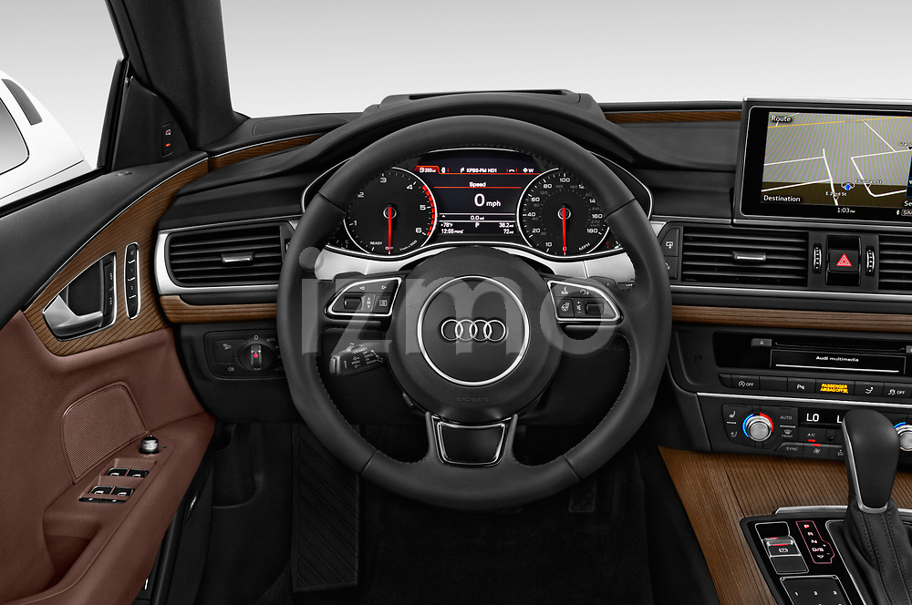 Car pictures of steering wheel view of a 2016 Audi A7 3.0 TDI Premium Plus  4 Door Hatchback