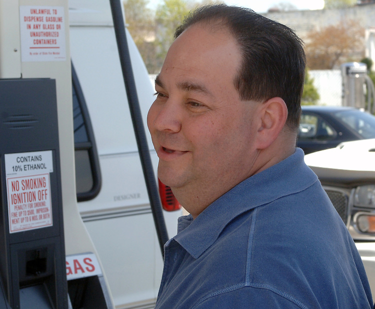 Kevin Jacobsen of Islip Terrace is among the customers filling up on gasoline being sold at Mike's Super Citgo station in West Babylon for $1.00 less than usual prices between 11 AM and 2 PM on Thursday April 27, 2006. (Photo / Jim Peppler).
