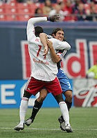 New York Red Bulls' Jozy Altidore (17) is grabbed by San Jose Earthquakes' Nick Garcia (3) during a corner kick in the first half of an MLS soccer match at Giants Stadium in East Rutherford, N.J. on Sunday, April 27, 2008. The Red Bulls defeated the Earthquakes 2-0.