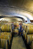 USA, Oregon, Willamette Valley, portrait of a young woman Catherine Douglas in the barrel room at Andelsheim Vineyard and Winery