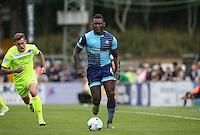 Aaron Pierre of Wycombe Wanderers heads forward under pressure from Sammie Szmodics of Colchester United during the Sky Bet League 2 match between Wycombe Wanderers and Colchester United at Adams Park, High Wycombe, England on 27 August 2016. Photo by Andy Rowland.