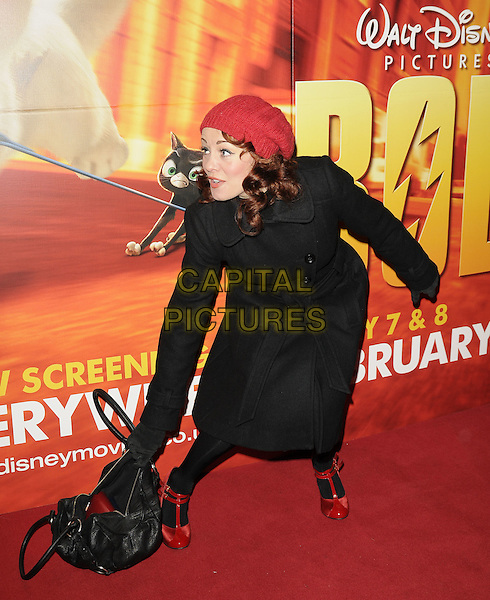 """SARAH CAWOOD .The """"Bolt"""" VIP screening, Cineworld cinemas, Haymarket, London, England..February 1st, 2009.full length black coat jacket red hat sara bag purse bending leaning shoes.CAP/CAN.©Can Nguyen/Capital Pictures."""