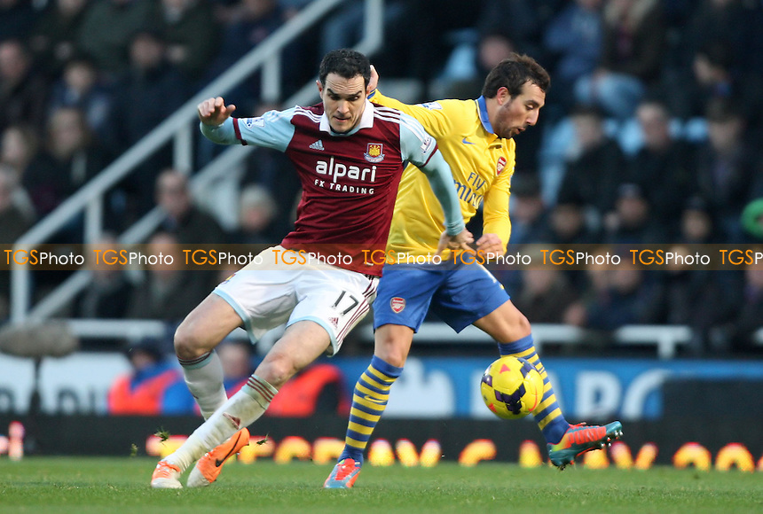 Joey O'Brien of West Ham and Santi Cazorla of Arsenal - West Ham United vs Arsenal, Barclays Premier League at Upton Park, West Ham - 26/12/13 - MANDATORY CREDIT: Rob Newell/TGSPHOTO - Self billing applies where appropriate - 0845 094 6026 - contact@tgsphoto.co.uk - NO UNPAID USE