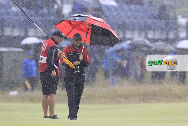 David HOWELL (ENG) in the rain on the 3rd green during Sunday's Round  of the 144th Open Championship, St Andrews Old Course, St Andrews, Fife, Scotland. 19/07/2015.<br /> Picture Eoin Clarke, www.golffile.ie