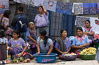 Stallholders in Santiago Atitlan market wearing the traditional clothing of the village.