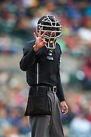 Umpire Roberto Ortiz signals for three baseballs during a game between the Toledo Mudhens and Rochester Red Wings on June 12, 2016 at Frontier Field in Rochester, New York.  Rochester defeated Toledo 9-7.  (Mike Janes/Four Seam Images)
