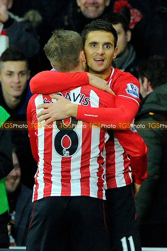 Dusan Tadic of Southampton right and Steven Davis of Southampton celebrate the second goal - Southampton vs Arsenal - Barclays Premier League Football at St Mary's Stadium, Southampton, Hampshire - 01/01/15 - MANDATORY CREDIT: Denis Murphy/TGSPHOTO - Self billing applies where appropriate - contact@tgsphoto.co.uk - NO UNPAID USE