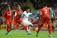 Jefferson Montero is tackled by Jordan Henderson during the Barclays Premier League Match between Liverpool and Swansea City played at Anfield, Liverpool on 29th November 2015