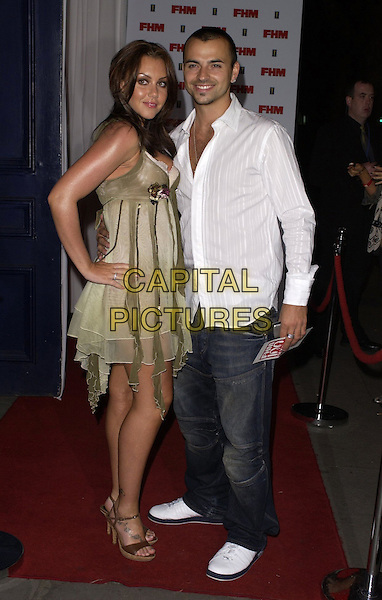 MICHELLE HEATON & ANDY SCOTT-LEE.The FHM 100 Sexiest Women In The World Party 2006 at Madame Tussauds, London, UK. .May 3rd, 2006.Ref: CAN.full length green dress jeans denim white shirt couple.www.capitalpictures.com.sales@capitalpictures.com.©Capital Pictures
