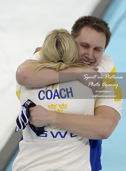 Swedish coach Eva Lund celebrates with Fredrik Lindberg (SWE). Mens curling - Bronze medal match - SWE v CHN - Ice Cube Curling Centre - Olympic Park - PHOTO: Mandatory by-line: Garry Bowden/SIPPA/Pinnacle - Photo Agency UK Tel: +44(0)1363 881025 - Mobile:0797 1270 681 - VAT Reg No: 768 6958 48 - 210214 - 2014 SOCHI WINTER OLYMPICS - Ice Cube Curling Centre, Sochi, Russia