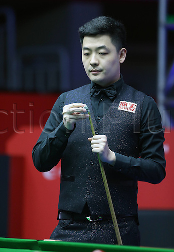 30.03.2016. Beijing, China.  Tian Pengfei of China competes during the first round match against Barry Hawkins of England at the 2016 World Snooker China Open in Beijing,