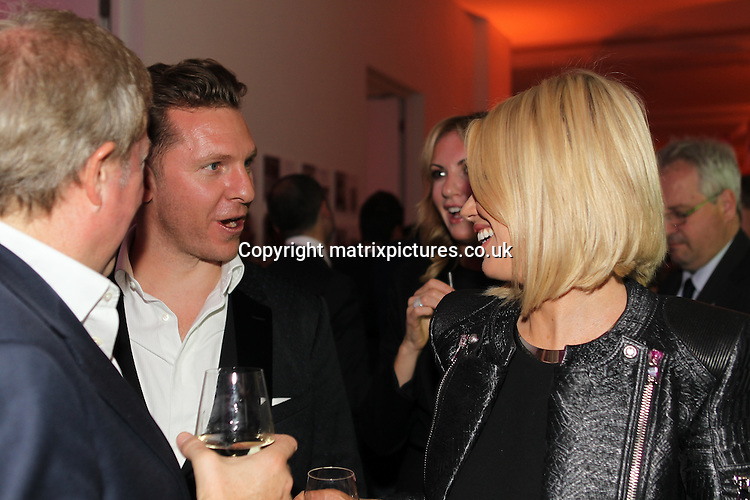 NON EXCLUSIVE PICTURE: TREVOR ADAMS / MATRIXPICTURES.CO.UK<br /> PLEASE CREDIT ALL USES<br /> <br /> WORLD RIGHTS<br /> <br /> British luxury property developer Nick Candy and Caroline Stanbury attending the CANDY Magazine Autumn/Winter 2013 Launch Party, hosted by Nick Candy at the Saatchi Gallery in King's Road, London.<br /> <br /> OCTOBER 15th 2013<br /> <br /> REF: MTX 136759