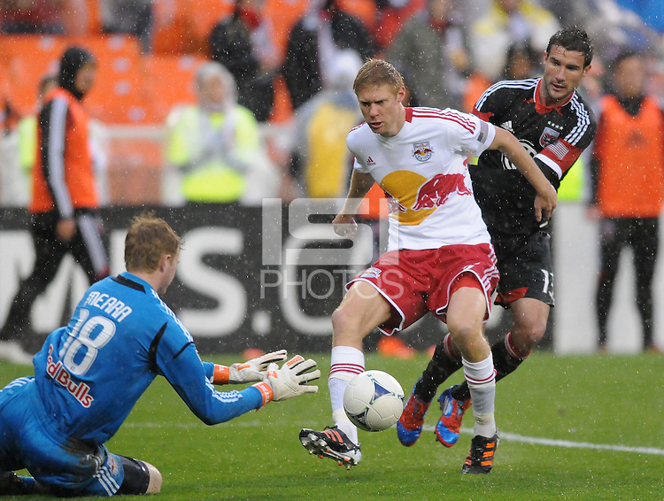 New York Red Bulls goal keeper Ryan Meara (18) goes down to make a save while New York Red Bulls defender Markus Holgersson (5) shield the ball from D.C. United forward Chris Pontius (13) D.C. United defeated The New York Red Bulls 4-1 at RFK Stadium, Sunday April 22, 2012.
