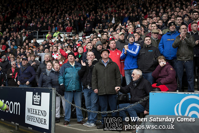 Derby County 1 Nottingham Forest 2, 17/01/2015. iPro Stadium, Championship. Away fans keeping their eyes on the action during the second-half of Derby Country's Championship match against Nottingham Forest at the iPro Stadium, Derby. The match was won by the visitors by 2 goals to 1, watched by a derby-day crowd of 32,705. The stadium, opened in 1997, was formerly known as Pride Park. Photo by Colin McPherson.
