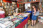 People browsing secondhand books inside Reed Books bookshop, Aldeburgh, Suffolk, England, UK