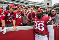 Hawgs Illustrated/BEN GOFF <br /> D'Vone McClure, Arkansas safety, greets players on the youth baseball team he coaches Saturday, April 6, 2019, after the Arkansas Red-White game at Reynolds Razorback Stadium.